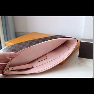 LV pink clutch bag